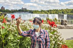 Free Woman Taking A Selfie With Niagara Falls In The Background. Stock Photography - 194902002