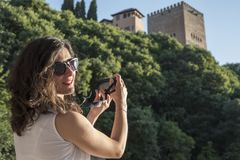 Woman taking alhambra picture stock photography