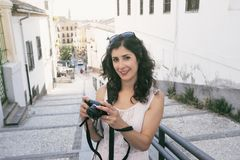 Woman taking alhambra picture Royalty Free Stock Photography
