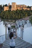 Woman taking alhambra picture royalty free stock photos