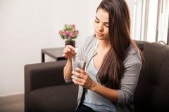 Woman taking antacid Stock Image