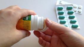 Woman taking aspirin medicine stock video