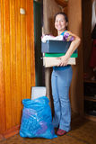Woman taking away the garbage. Mature woman taking away the garbage at home Royalty Free Stock Image