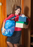 Woman taking away the garbage. Young woman taking away the garbage at home Stock Photography
