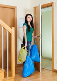 Woman taking away the garbage out home Stock Images