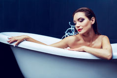 Woman taking a bath. Beautiful woman taking a bath   at home Royalty Free Stock Images