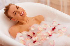 Woman taking a bath Stock Photos