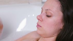 Woman is taking a bath. Crying with red eyes in depression.