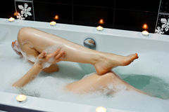 Woman taking bath. Royalty Free Stock Photos