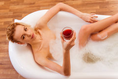 Woman taking a bath Royalty Free Stock Photos