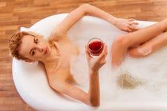 Woman taking a bath Royalty Free Stock Photos
