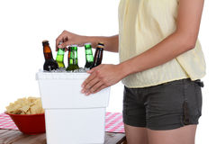 Woman Taking Beer From Ice Chest Stock Images