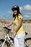 Woman taking a bike ride Stock Photo