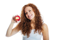 Woman taking a bite out of an apple Royalty Free Stock Photo