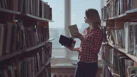 Woman taking the books stock video footage