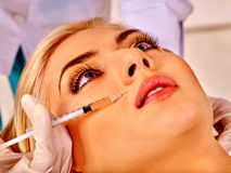 Woman taking botox injections Royalty Free Stock Photo