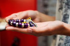 Woman taking a bracelet in a jewelry Stock Photography