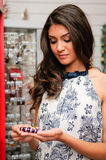 Woman taking a bracelet in a jewelry store Royalty Free Stock Photos