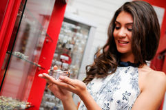 Woman taking a bracelet in a jewelry store Stock Photo