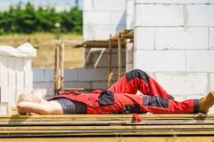 Woman taking break on construction site stock photography