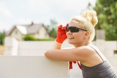 Woman taking break on construction site stock images