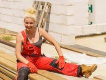 Woman taking break on construction site stock photos