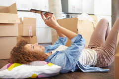Woman Taking A Break With Digital Tablet In New Home Stock Image