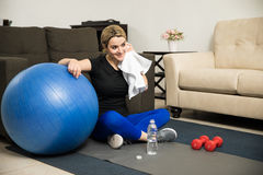 Woman taking a break from exercising at home Royalty Free Stock Photos