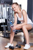 Woman taking a break at the gym Stock Photo