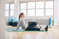 Woman taking break from her workout at gym Royalty Free Stock Image