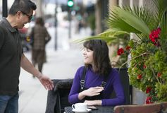Woman Waiting for a Friend at a Local Sidewalk Cafe royalty free stock photo