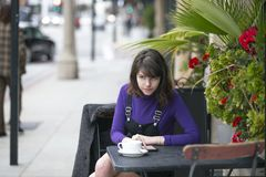 Woman Waiting for a Friend at a Local Sidewalk Cafe royalty free stock images