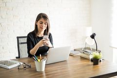 Woman taking a break from work Stock Images
