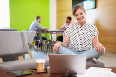 Woman Taking A Break Working In Design Studio Royalty Free Stock Photography