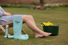Woman taking a break from working in the garden Stock Images