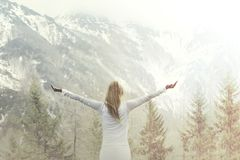 Woman taking a breath in front of a majestic mountain stock photos