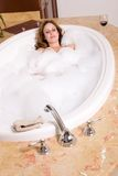 Woman taking bubble bath Royalty Free Stock Photo