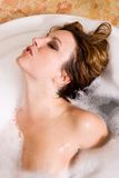 Woman taking bubble bath Stock Photography