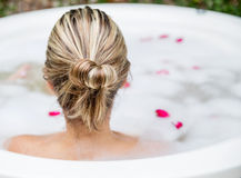 Woman taking a bubble bath Stock Photos
