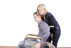 Woman taking care of disabled man Royalty Free Stock Image