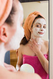 Woman taking care of face Stock Photo