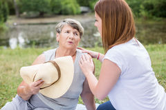 Woman taking care of grandmother Stock Photo