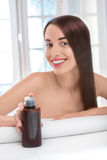 Woman taking care of hair in spa salon Stock Image