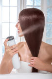 Woman taking care of hair in spa salon Royalty Free Stock Image