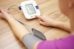 Woman is taking care for health with hearth beat monitor. And blood pressure stock images