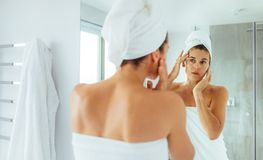 Woman taking care of her body after bath Stock Photography
