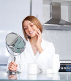 Woman taking care of her face Stock Photos