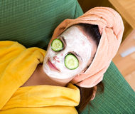Woman taking care of her face Stock Photography