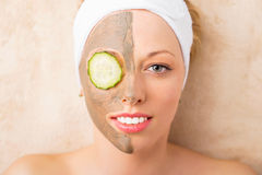 Woman taking care of her face in spa treatments Stock Photo