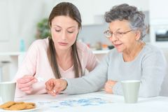 Woman taking care grandmother. Woman taking care of her grandmother Royalty Free Stock Image